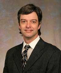 Dr. Chuck M. Hermans