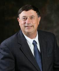 Dr. Les E. Heitger