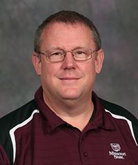 Dr. Douglas E. Greiner
